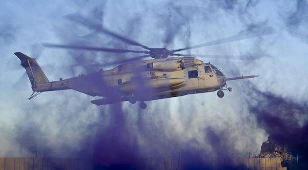 A US Marine Corps CH-53 Sea Stallion helicopter prepares to land at a patrol base in Helmand Province