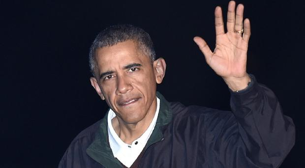 A relaxed Barack Obama returns to the White House unrepentant over his immigration reforms announced in Las Vegas (AP)
