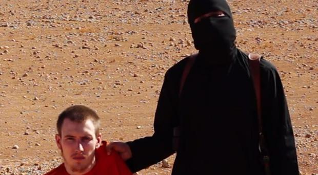 The British IS militant nicknamed Jihadi John says Mr Kassig, left, is next to be beheaded, in a video showing the murder of British hostage Alan Henning