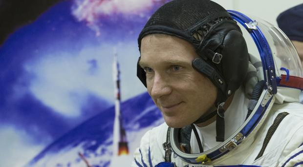 American Terry Virts and his fellow astronauts in the Soyuz-FG rocket have docked with the International Space Station. (AP)