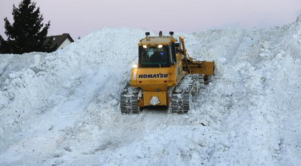 Snow is moved from Buffalo neighbourhoods following severe wintry weather (AP)