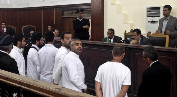 Lawyers said Mohammed Fahmy, centre, should benefit from the new law, or be released because he suffers from Hepatitis C (AP)