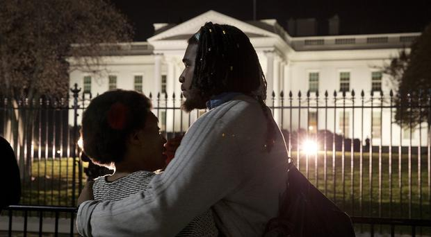 Bonnie Mills, 19, left, is hugged by a friend as they gather with students from Howard University and others in front of the White House in reaction to the Ferguson grand jury decision not to indict police officer Darren Wilson over the shooting death of Michael Brown (AP Photo/Jacquelyn Martin)