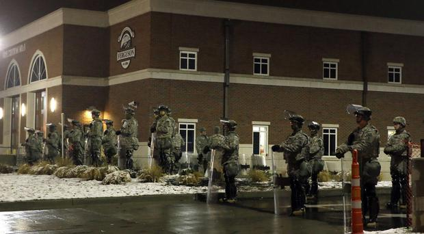 Missouri National Guard stand outside the Ferguson Police Department (AP)