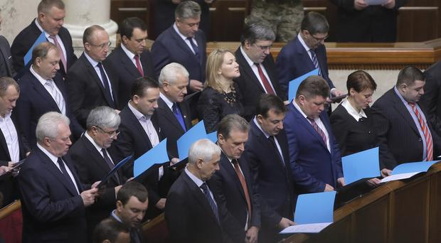 Newly-elected Ukrainian parliament deputies swear their oath during the inauguration ceremony in Kiev (AP)