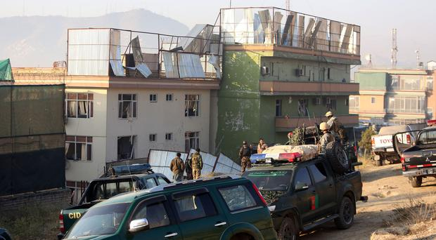 Afghan security forces inspect the site of the attack in Kabul (AP)