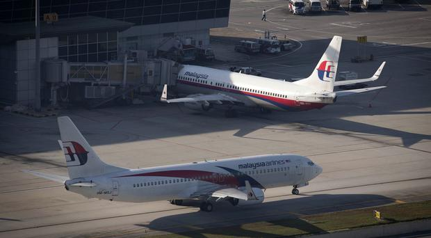 Malaysia Airlines' fortunes have suffered after two deadly passenger jet disasters. (AP)
