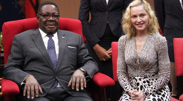 Madonna with Malawian President Peter Mutharika. (AP)