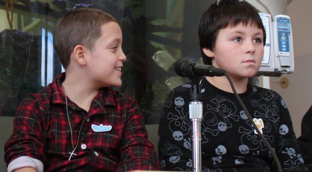 Jason Rivera, left, and Elijah Martinez appear at a news conference at the hospital where they are recovering (AP/Times Herald Record)