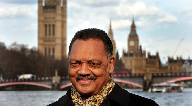 A gathering over the Missouri shooting death of a black man by a white police officer included a speech by the Reverend Jesse Jackson