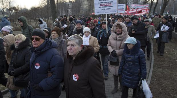 Protesters march during a doctors' rally against job cuts and hospital closures in Moscow, Russia (AP)