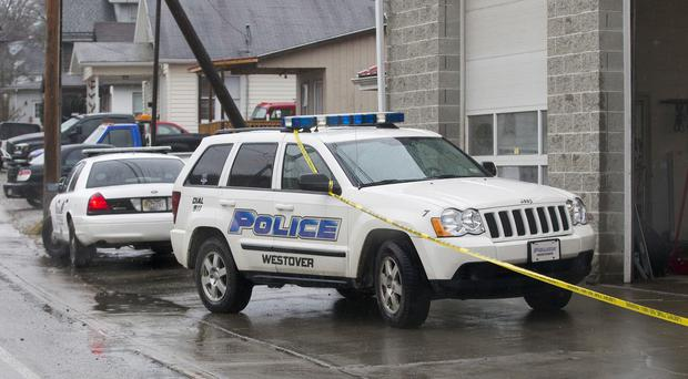 Police investigate in Westover, West Virginia, after separate shootings left four people dead (AP)