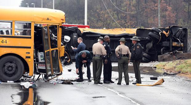 Authorities work the scene of an accident involving two school buses in Knoxville (Knoxville News Sentinel/AP)