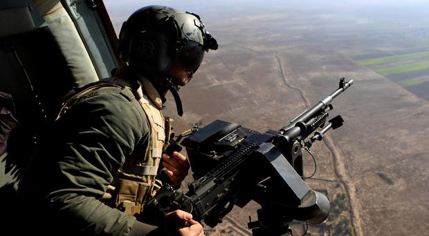 Iran has launched what may be its first air strikes against IS militants in Iraq, the US says (AP)