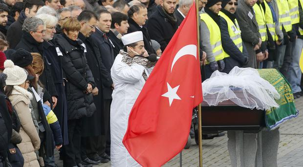 The Imam prays near the coffin with Tugce Albayrak during a funeral ceremony outside a mosque in Waechtersbach, Germany. (AP)