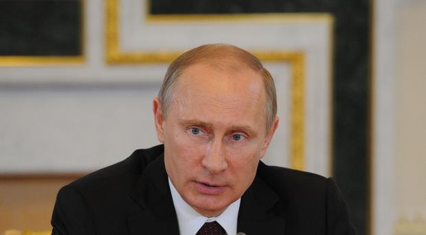 President Obama has questioned some of Vladimir Putin's policies