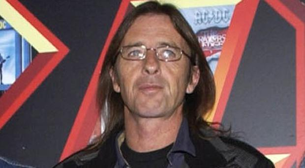 AC/DC drummer Phil Rudd scuffled with a witness in a pending court case