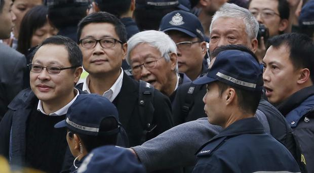 The founders of Occupy Central, who have called for an end to street protests in Hong Kong. (AP)