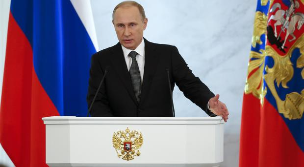 Russian president Vladimir Putin gives his annual state-of-the-nation address in the Kremlin in Moscow (AP)