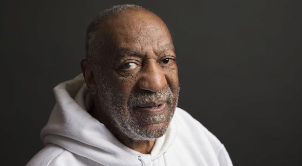 A woman who claims comedian Bill Cosby sexually assaulted her when she was 15 has spoken to police in Los Angeles (Invision/AP)