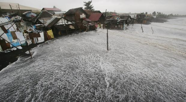 Strong waves crash into coastal houses as Typhoon Hagupit pounds Legazpi, Albay province, eastern Philippines