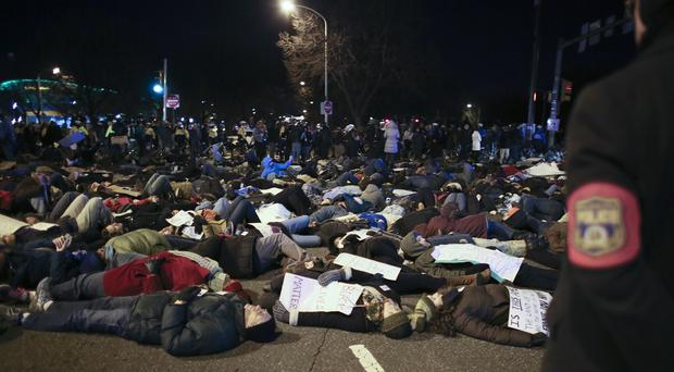 Protesters stage a die-in demonstration in Philadelphia over the deaths of two unarmed black men at the hands of police (AP)