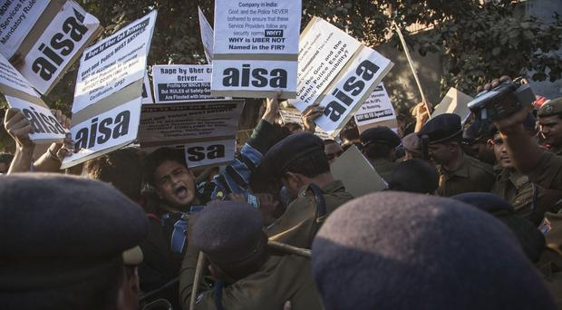 Protestors from All India Students Association demonstrate outside the Delhi police headquarters after a taxi driver allegedly raped a young woman (AP)