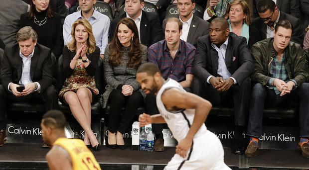 The Duke and Duchess of Cambridge watch an NBA basketball game between the Brooklyn Nets and the Cleveland Cavaliers (AP)