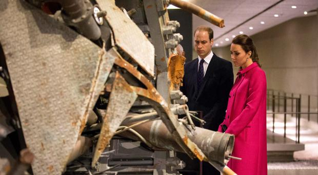 The Duke and Duchess of Cambridge pause at a piece of debris from the North Tower of the World Trade Centre during their tour of New York yesterday