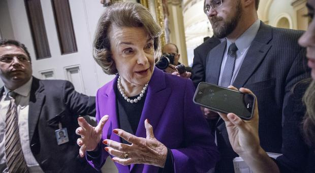 Senate Intelligence Committee chair Dianne Feinstein speaks to reporters after releasing a report on the CIA's harsh interrogation techniques (AP)