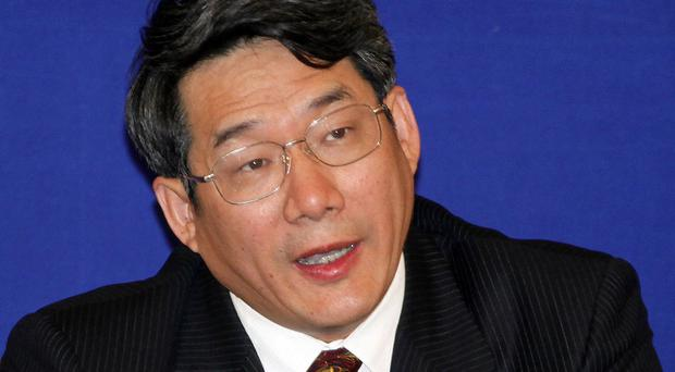 Liu Tienan, former vice chairman of China's National Development and Reform Commission, has been jailed for life over taking bribes (AP)