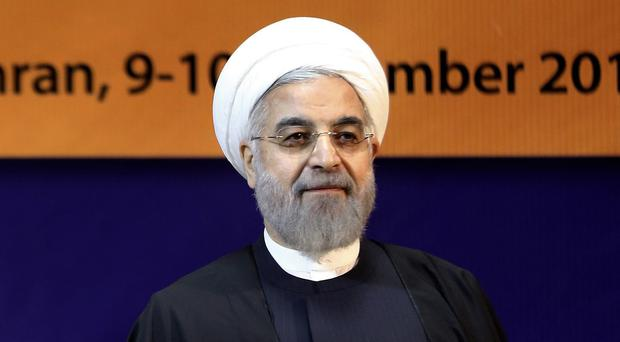 Hassan Rouhani told a cabinet meeting the fall in prices is 'politically motivated' (AP)