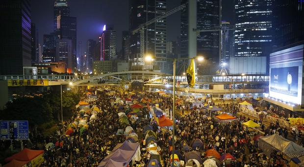 Protesters gather at the occupied area outside government headquarters in Hong Kong (AP)