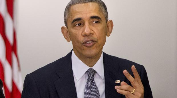 President Barack Obama phone wavering Democrats in a bid to help pass the bill through the House of Representatives (AP)