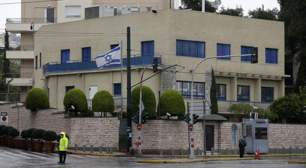 Police stand guard outside the Israeli embassy after a pre-dawn gun attack. (AP)
