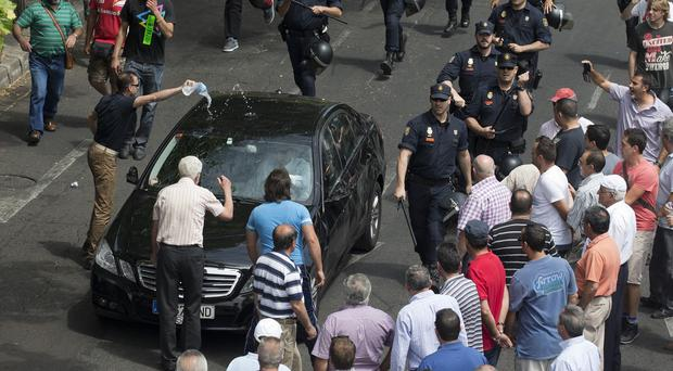 A confrontation during a 24-hour taxi strike and protest against Uber drivers. (AP)