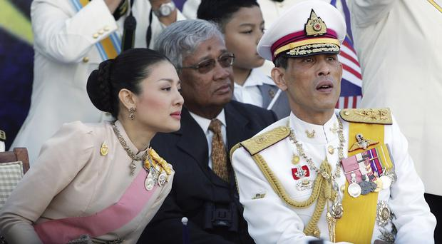 Thailand's Crown Prince Vajiralongkorn, right, pictured with his royal consort Princess Srirasm in 2007 (AP)