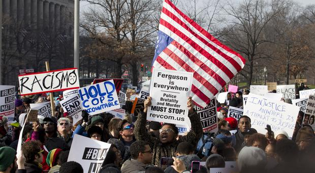 Demonstrators chant at Freedom Plaza in Washington during the Justice For All rally and march (AP Photo/Jose Luis Magana)
