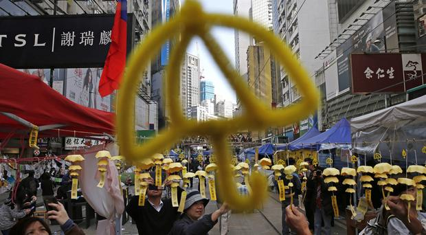 Yellow umbrella decorations are put up by pro-democracy protesters in the Causeway Bay district of Hong Kong (AP)