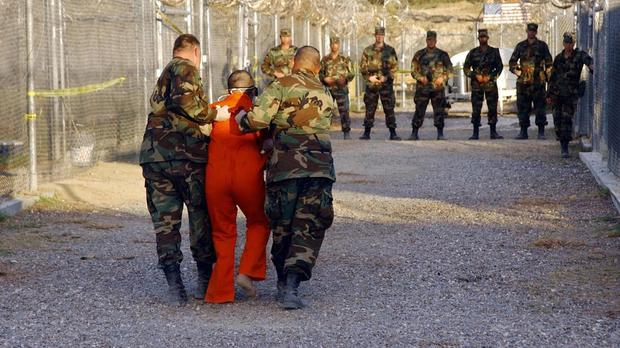 US Army Military Police escort a detainee to his cell at Guantanamo Bay, Cuba. (US Department of Defence/PA)
