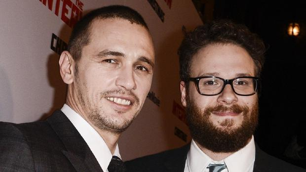The Interview stars Seth Rogen, right, and James Franco have pulled out of media appearances amid threats by hackers against cinemas showing the film (Invision/AP)
