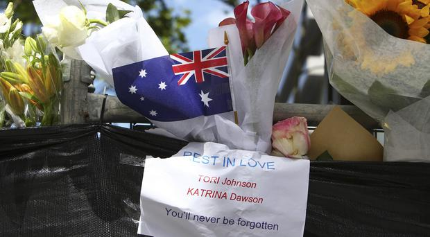 Floral tributes honour Sydney gun siege victims Tori Johnson and Katrina Dawson (AP)