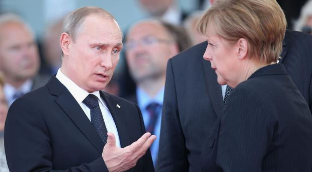 Angela Merkel has called Vladimir Putin as Russia's economy suffers with a plunging currency