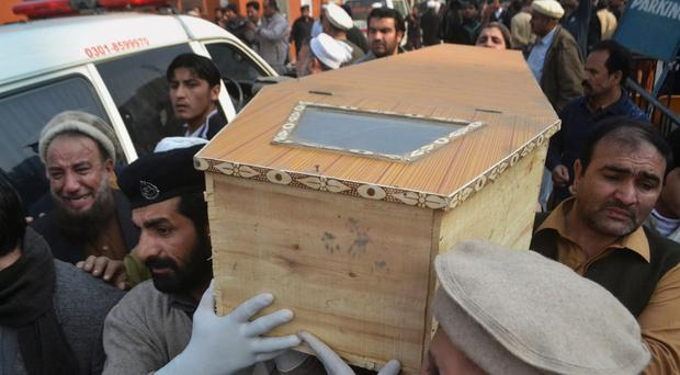 Relatives carry the coffin of a victim yesterday