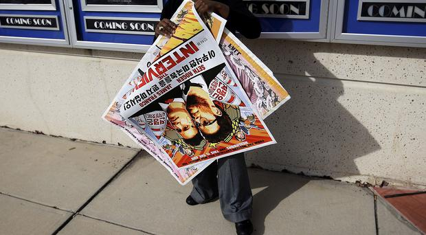 A poster for The Interview is pulled from a display case at a Carmike cinema complex in Atlanta, Georgia (AP)
