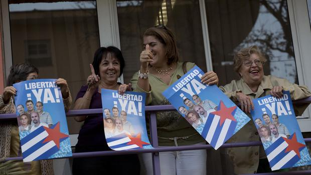 Women with posters of the Cuban Five celebrate in Havana (AP)