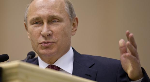 Vladimir Putin has released another detained Russian tycoon. (AP)