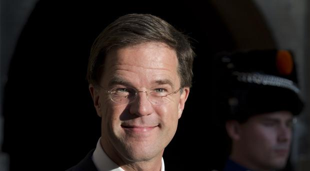 Mark Rutte's conservative VVD party and left-leaning junior coalition partner Labour lack a majority (AP)