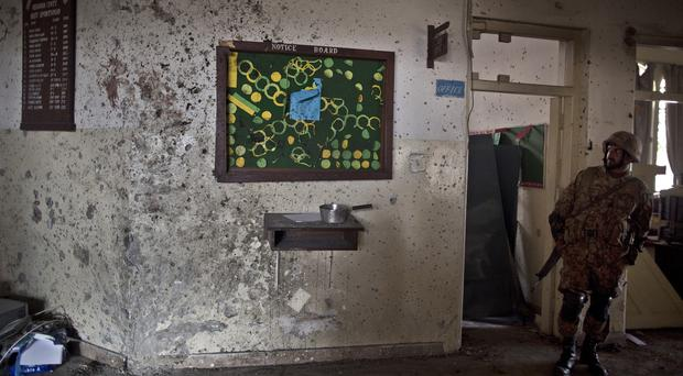 A wall is riddled with bullet holes after the massacre at the Army Public School in Peshawar (AP)