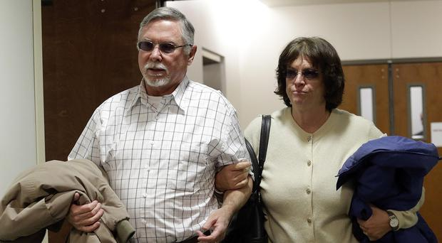 Robert and Arlene Holmes, the parents of Aurora cinema shooting suspect James Holmes, have pleaded for him to be spared the death penalty (AP)